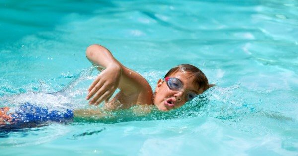 close-up-of-young-boy-at-swimming-practice-outdoors